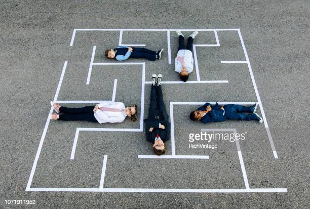 young business team happy in maze. - adult imitation stock pictures, royalty-free photos & images