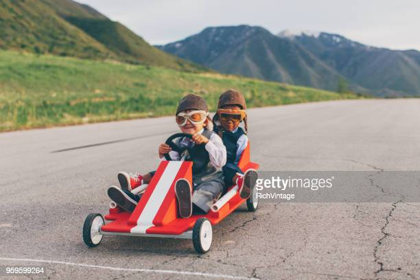 young business team of boys race a go cart - goal sports equipment stock pictures, royalty-free photos & images