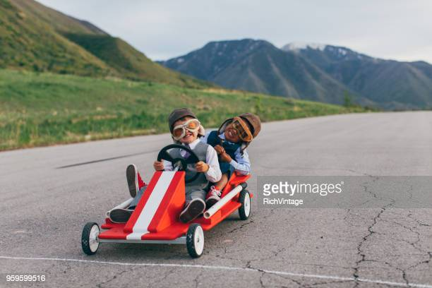young business team of boys racing go carts - sports team event stock photos and pictures