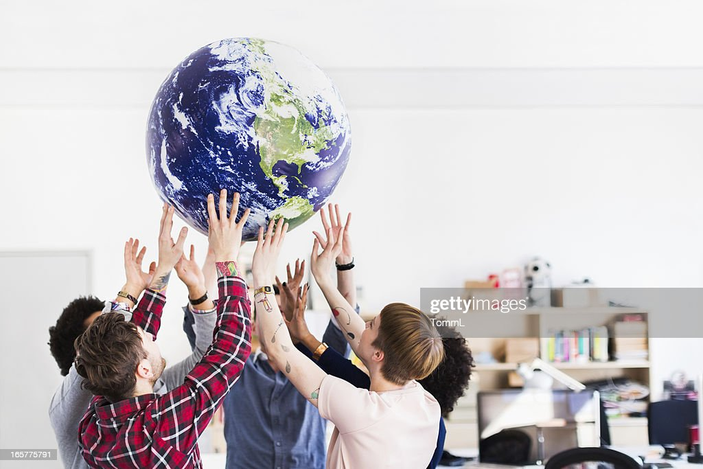 Young Business Team Playing With Earth Globe : Stock Photo