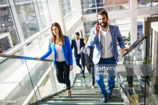 Young business team walking upstairs