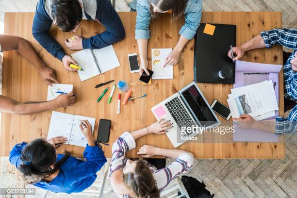 young business team working together at office - en:creative stock pictures, royalty-free photos & images