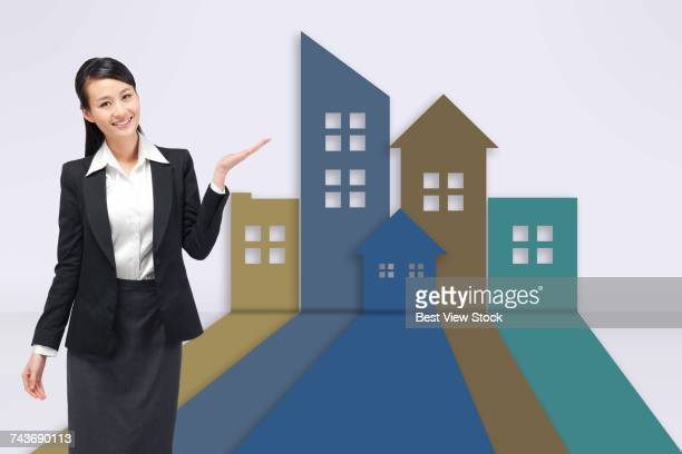 Young business woman and building