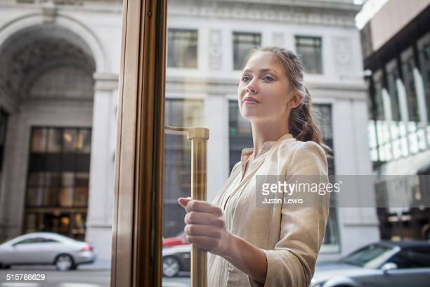 young business woman entering building - entering stock pictures, royalty-free photos & images