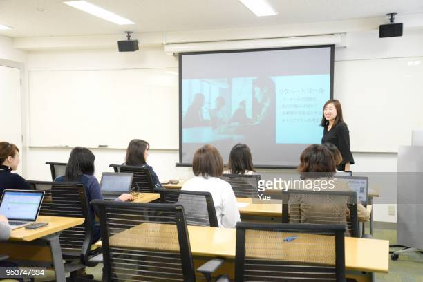 young business woman giving a presentation - seminar stock pictures, royalty-free photos & images