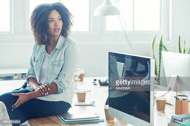 Young business woman in studio.