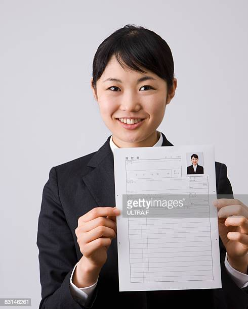 Young business woman is smiling.