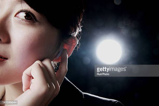 young business woman listening to music,close-up