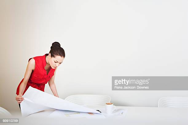 A young business woman looking at plans
