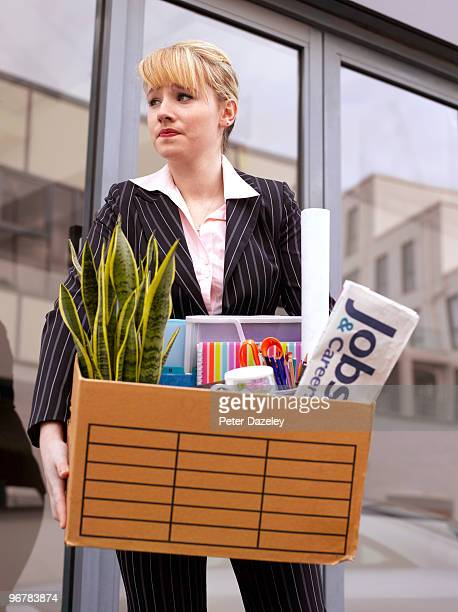 young business woman made redundant  - downsizing unemployment stock pictures, royalty-free photos & images