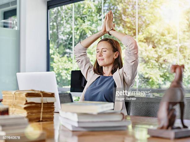 meditation office. Young Business Woman Meditating In Her Office Meditation