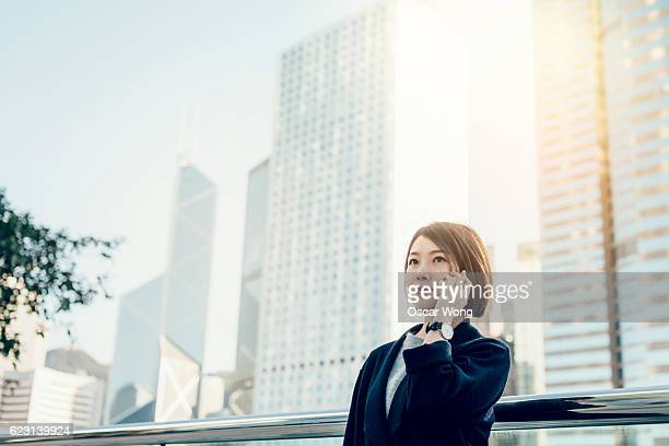 Young business woman on a call outddoors