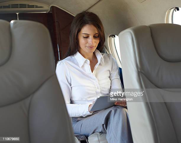 Young Business Woman On Plane