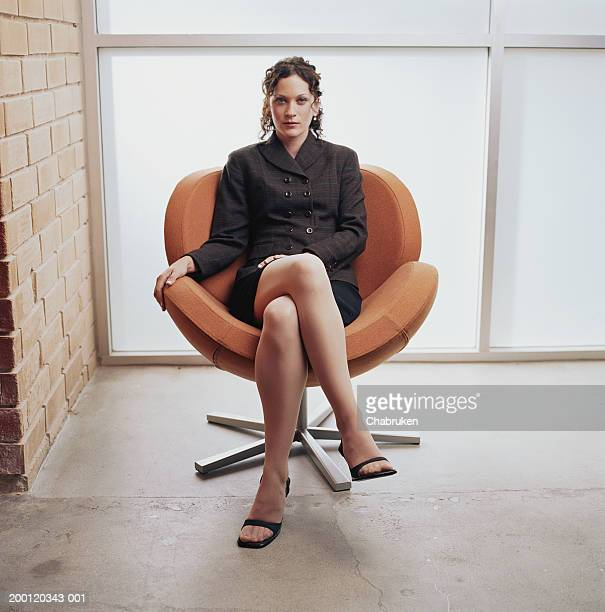 young business woman sitting in chair, portrait - 椅子 ストックフォトと画像