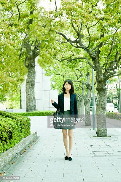 Young business woman standing in city location