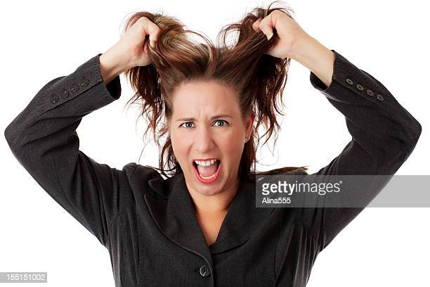 Young business woman tearing her hair out