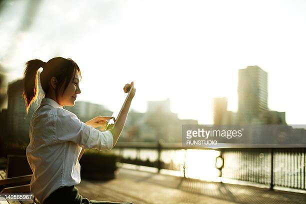 young business woman touching tablet