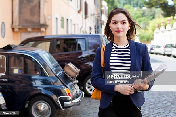 young business woman walking down the street