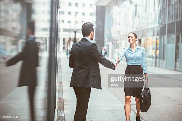 young business woman with a colleague in the business district