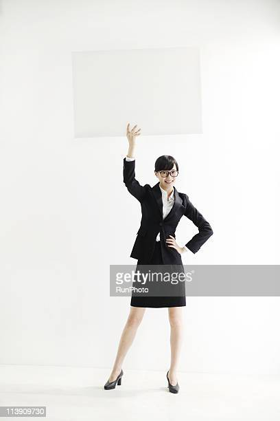young business woman with a panel - prop stock pictures, royalty-free photos & images