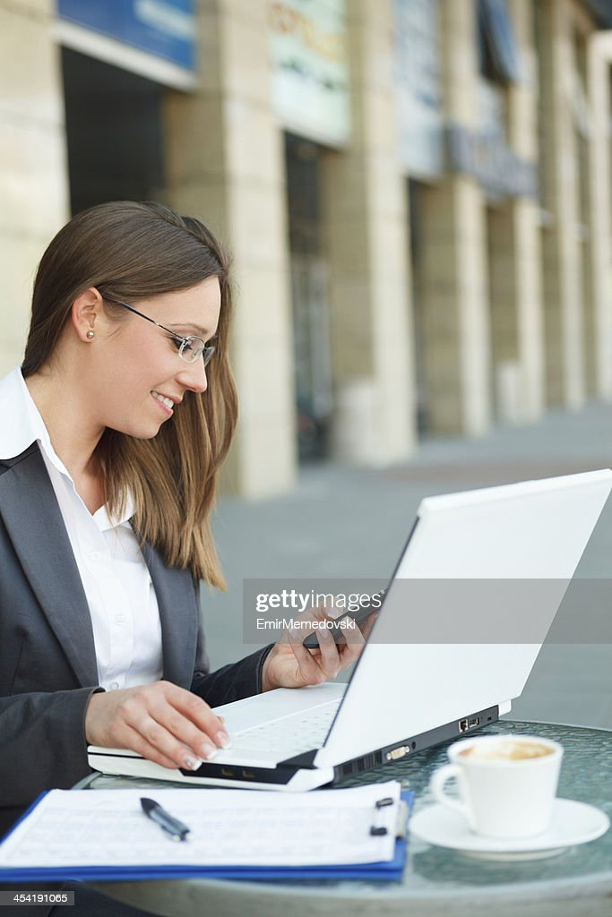 Young business woman with mobile phone : Stock Photo
