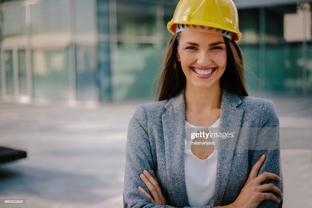577d9f37c3b Young business woman with yellow helmet   Stock Photo
