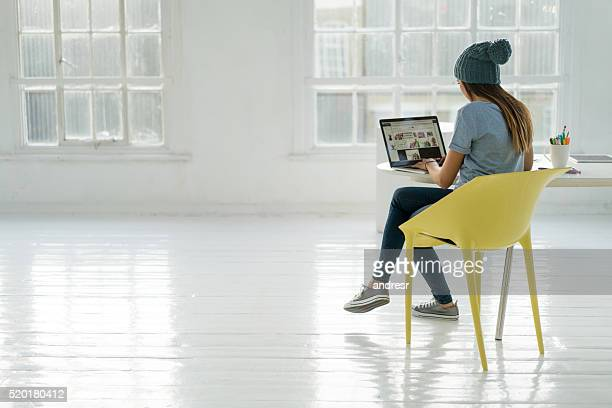 Young business woman working online