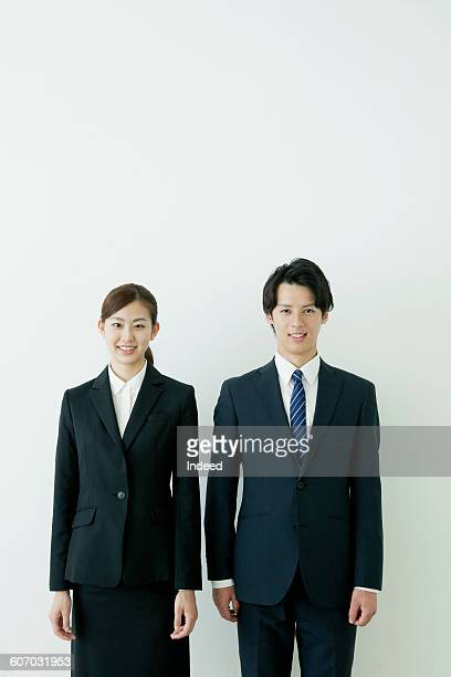 Young businessman and woman smiling