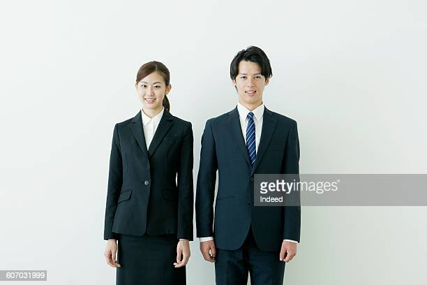 young businessman and woman smiling - suit ストックフォトと画像