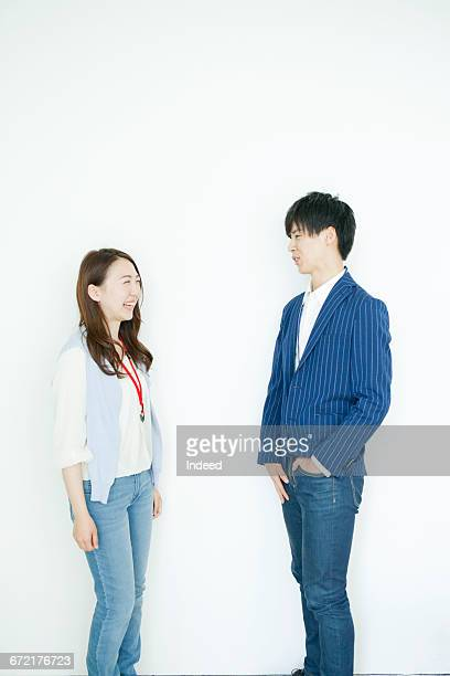 Young businessman and woman talking face to face