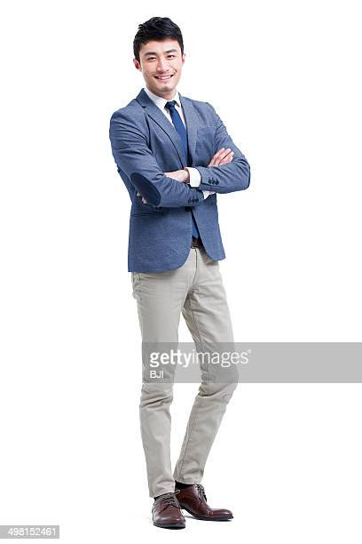 Young businessman arms crossed