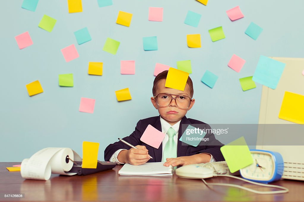 Young Businessman at Desk Covered with Blank Sticky Notes : Stock Photo