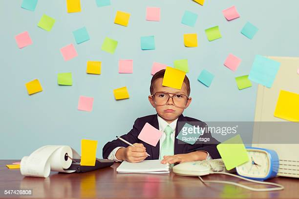young businessman at desk covered with blank sticky notes - 効率 ストックフォトと画像