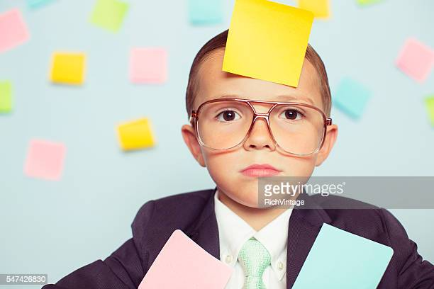 Young Businessman at Desk Covered with Blank Sticky Notes