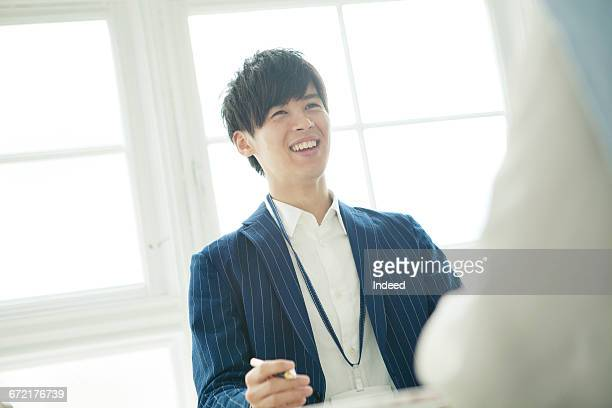 Young businessman at meeting