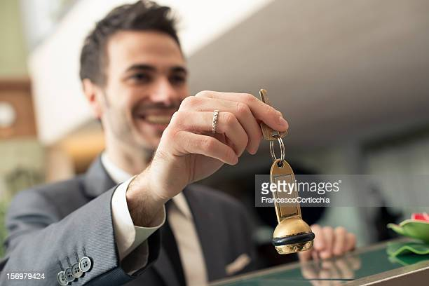 young businessman at the hotel - hotel key stock photos and pictures