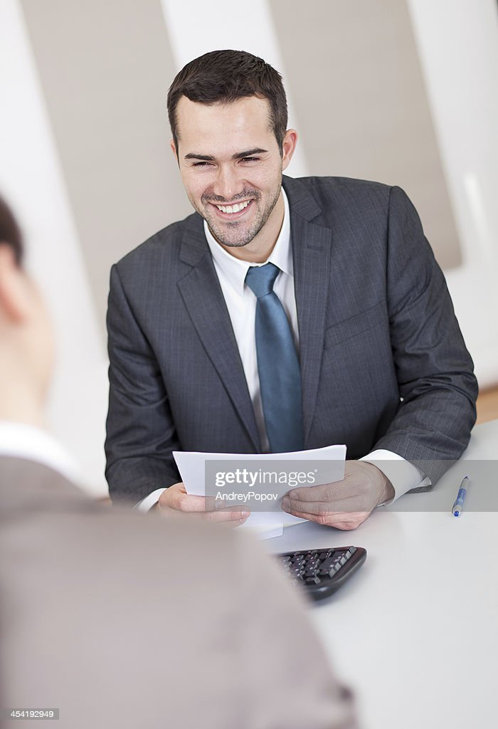 Young businessman at the interview : Stock Photo