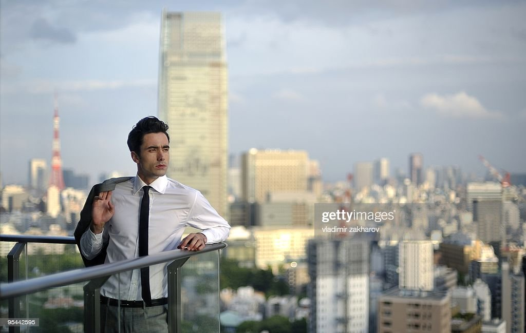 Young businessman at Tokyo's background : Stock Photo
