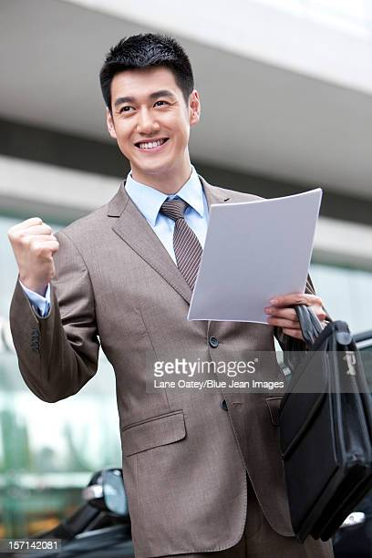 Young businessman celebrating
