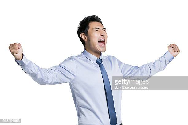 Young businessman cheering