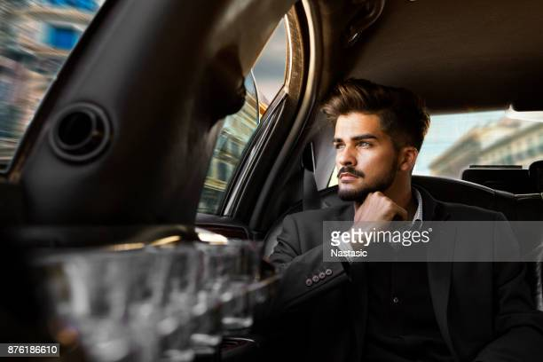 Young Businessman driving through city