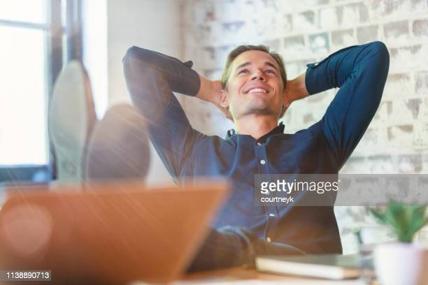 young businessman enjoying his success. - content stock pictures, royalty-free photos & images