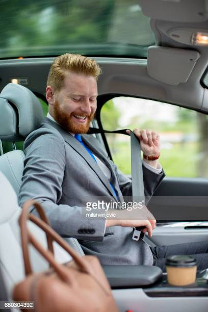 Young businessman entering the car
