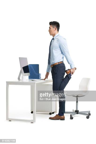 young businessman exercising in office - shirt and tie stock pictures, royalty-free photos & images