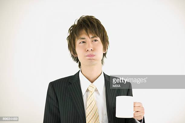 Young businessman gargling