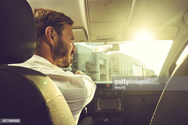 Young businessman going on a business trip by car.
