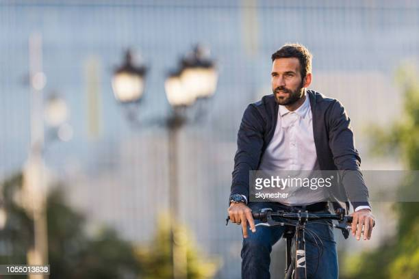 Young businessman going to work by bike.