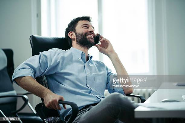 Young businessman having a pleasant conversation