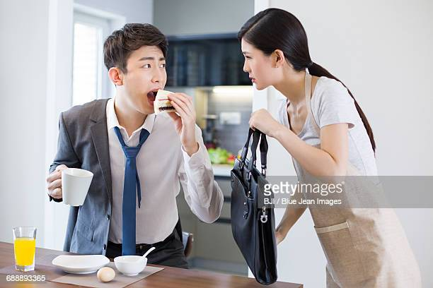 Young businessman having breakfast in a hurry
