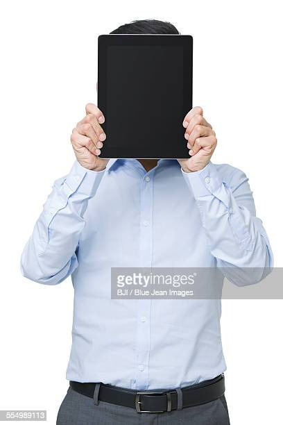 Young businessman holding a digital tablet